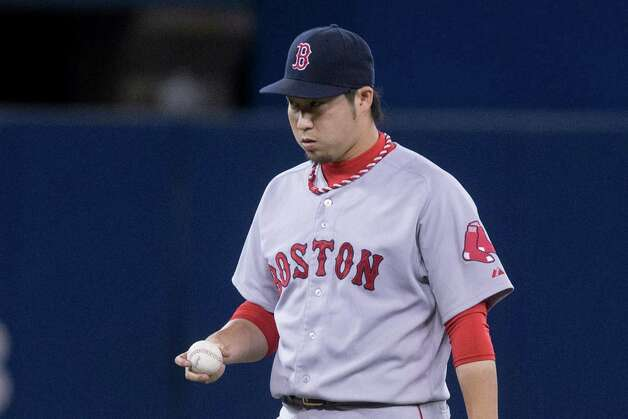 Boston Red Sox pitcher Junichi Tazawa reacts after Toronto Blue Jays' Danny Valencia hits a three run homer during seventh inning American League baseball action in Toronto on Wednesday, Aug. 27, 2014. (AP Photo/The Canadian Press, Chris Young) ORG XMIT: CHY123 Photo: Chris Young / CP