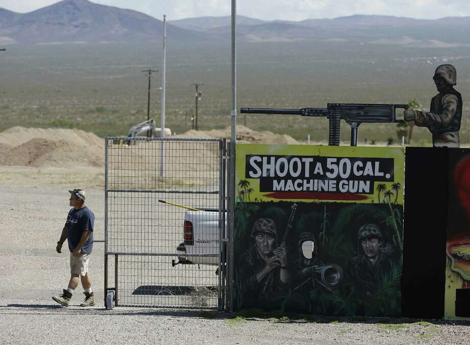 A man closes off an entrance to the Last Stop outdoor shooting range in White Hills, Ariz., where a gun instructor was accidentally killed. Photo: John Locher, Associated Press / AP