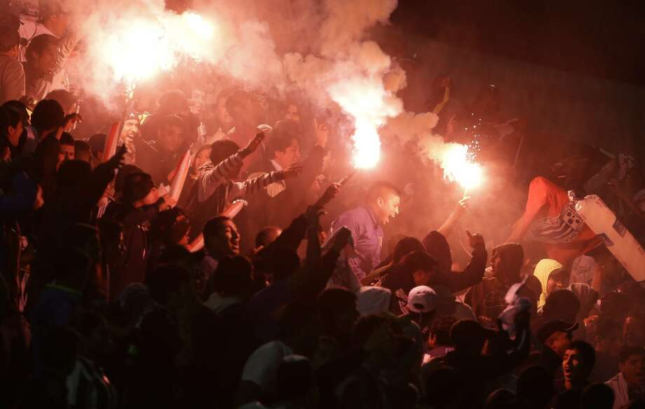 Fans of Peru's Alianza Lima, cheer their for team with flares during a Copa Sudamericana soccer match against Ecuador's Barcelona in Lima, Peru, Wednesday, Aug. 27, 2014. (AP Photo/Martin Mejia) Photo: Martin Mejia, Associated Press
