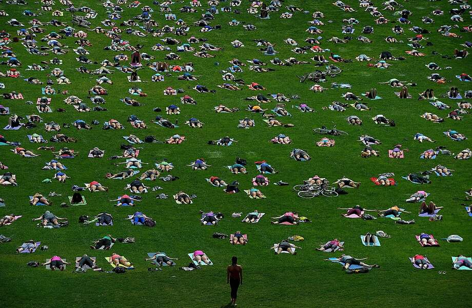"Health-minded Canadians take part in ""Yoga On The Hill"" on Parliament Hill in Ottawa. Photo: Sean Kilpatrick, Associated Press"