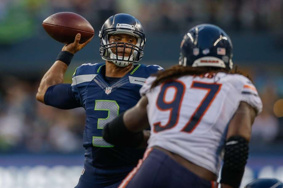 """1. Everybody plays — sort ofCarroll said on Tuesday that everyone on the Seahawks roster — including the presumed starters — would see some action against the Raiders. But after last week's dress rehearsal saw many of the Hawks' first-teamers — including quarterback Russell Wilson (above) — play into the second half, expect to seem them for only a series or two in Oakland.There's potential for a lackadaisical effort from those who've already earned spots on the team, but Thursday's game will be crucial for players on Seattle's roster bubble. Carroll said on Wednesday that the team hasn't yet finalized its roster choices. Keeping that in mind — and Carroll's """"always compete"""" mantra — expect to see the Hawks' reserves playing their hearts out well into the night against the lowly Raiders. Photo: Otto Greule Jr, Getty Images"""