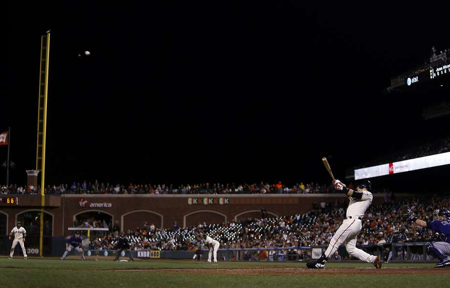 San Francisco Giants' Buster Posey hits a game-winning 2-run home run in 9th inning of 4-2 win over Colorado Rockies during MLB game at AT&T Park in San Francisco, Calif. on Wednesday, August 27, 2014. Photo: Scott Strazzante, The Chronicle