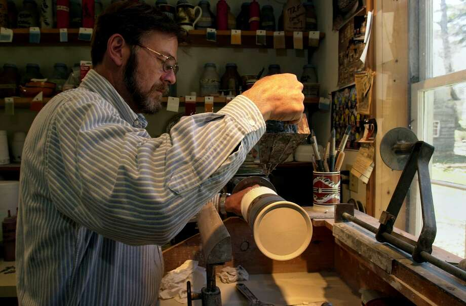 TIMES UNION PHOTO BY LUANNE M. FERRIS-- April 30, 2003, East Nassau, NY, Eastfield Village. Don Carpentier creates a mug in the formar Gorton School House, moved from Hancock, Mass. Photo: LUANNE M. FERRIS / TIMES UNION