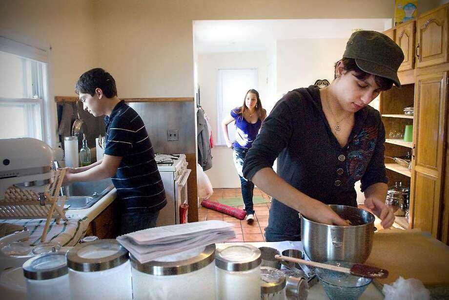UCONN Stamford students Henry Hernandez, 21, Melissa Martin, 19, and Emily Smalter, 19, bake cookies in an apartment on Stephen St. in Stamford, Conn. on Friday, Feb. 19,  2010.  The students are all members of SPECTRUM, Sexual Practices Examined Culturally Through Rainbow Unity Membership. Photo: Kathleen O'Rourke / Stamford Advocate