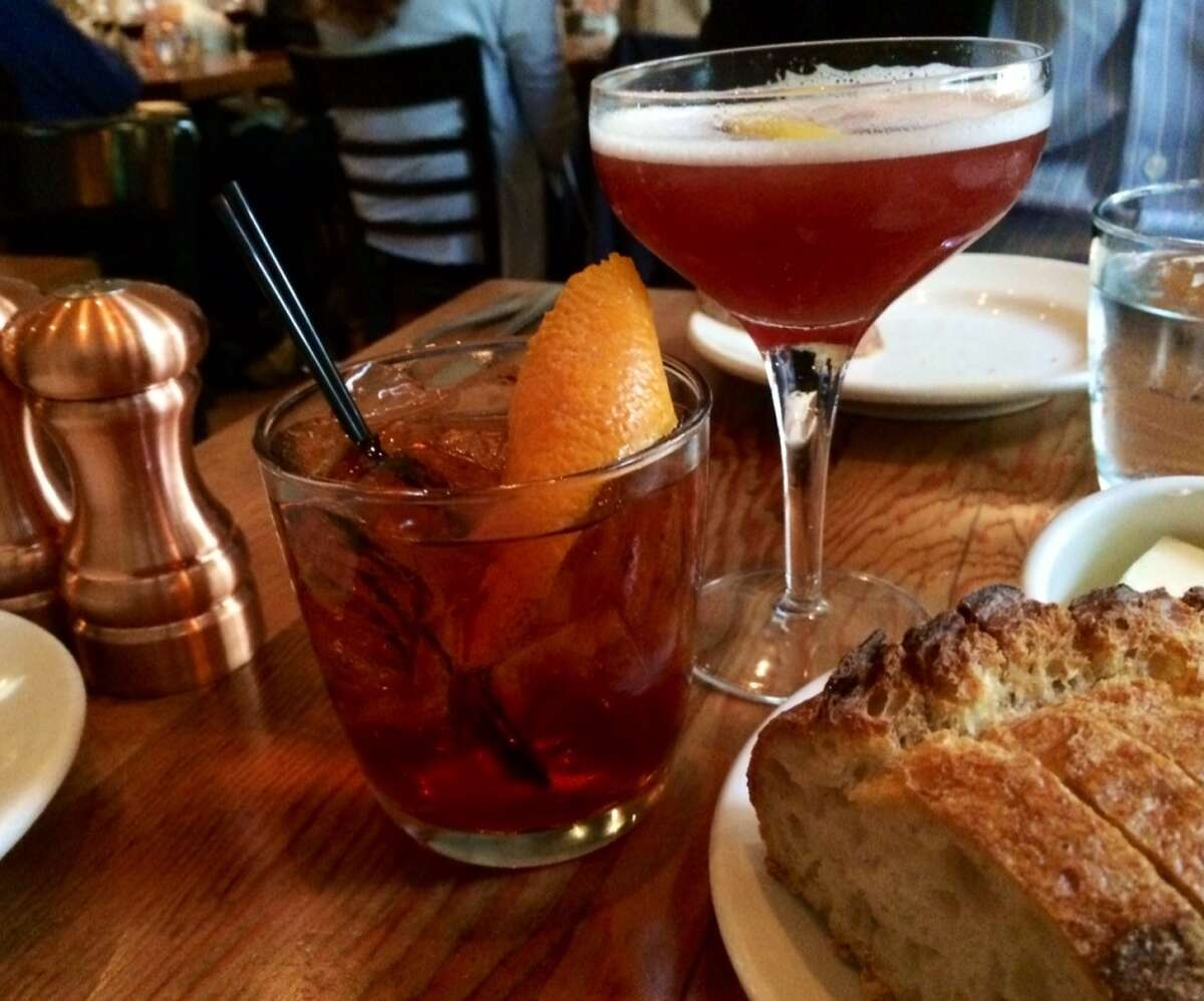 A negroni made with house barrel-aged gin ($12) and the Scofflaw ($10)