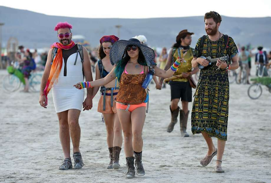 In this Monday, Aug. 25, 2014 photo, Burning Man participants walk on the playa at the annual Burning Man event in the Black Rock Desert of Gerlach, Nev. Photo: Andy Barron, Associated Press