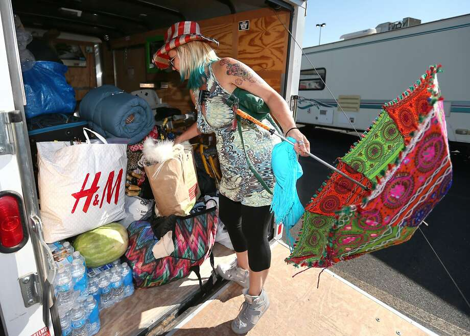 Burner Suzie Wyld, of Australia, stocks up Tuesday morning, Aug. 26, 2014, at a Wal-Mart in Reno, Nev., after a rare rain storm temporarily closed the entrance to Burning Man Monday. The Playa reopened at 6 a.m. for the weeklong counter-culture festival that draws 70,000 people to the Black Rock Desert.  Photo: Cathleen Allison, Associated Press
