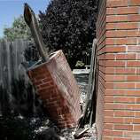 This chimney on Meadowbrook Drive in Napa, Calif was cut in half by the recent earthquake. Among the most damaged and dangerous aspects of homes in earthquake prone areas are brick chimneys which have been responsible for numerous injuries and deaths when they collapse in an earthquake.