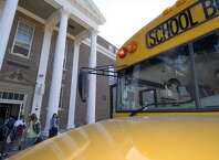 Students leave their bus and enter Van Antwerp Middle School in Niskayuna in this first day of school in 2007. (Skip Dickstein/Times Union archive)