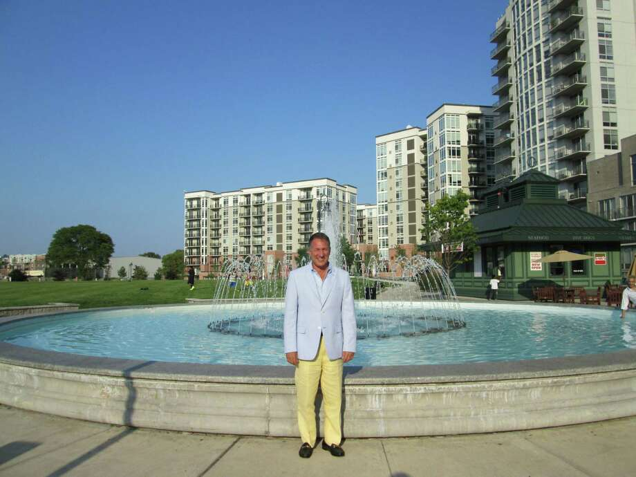 Carl Kuehner, CEO of Building and Land Technology, stands in Commons Park in the Harbor Point development located in Stamford's South End. Photo: Photo Courtesy Of Building And L, Contributed Photo / Stamford Advocate Contributed