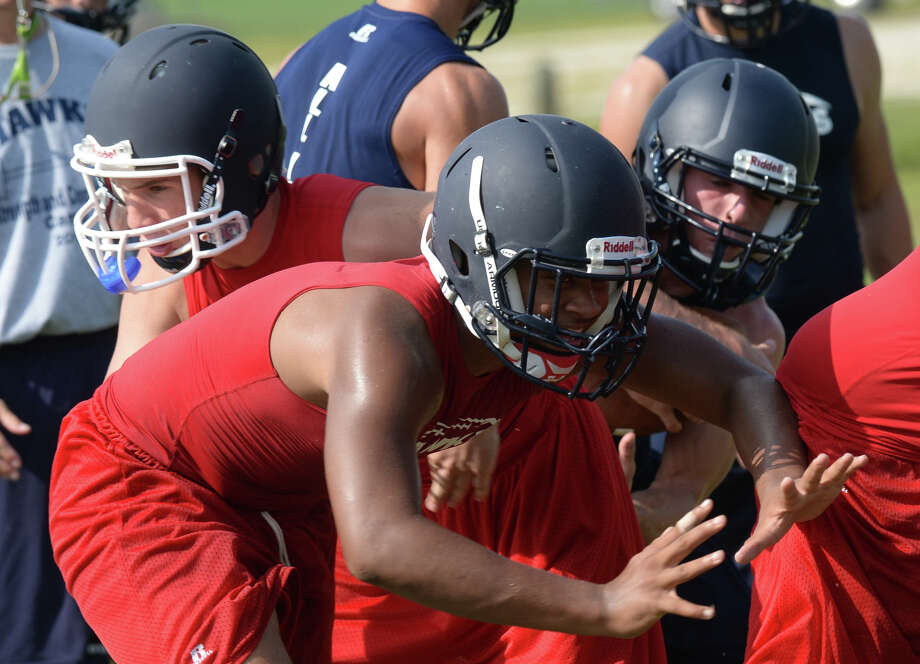 Hardin-Jefferson's Hawks run drills and plays on their field during practice on Thursday. Photo taken Thursday, August 07, 2014 Guiseppe Barranco/@spotnewsshooter Photo: Guiseppe Barranco, Photo Editor