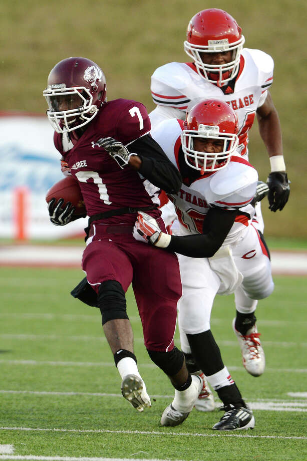 Silsbee's Sedrick Spearman, No. 7, tries to outrun Carthage's Christian Allison, No. 16, during Friday's game. Silsbee High School played against Carthage at Provost-Umphrey Stadium on Friday afternoon.  Photo taken Jake Daniels/@JakeD_in_SETX Photo: Jake Daniels / ©2013 The Beaumont Enterprise/Jake Daniels