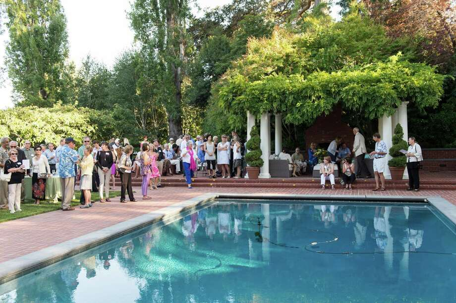 Guests gathered in the garden of a private Hillsborough home to raise money for CASA (Court Appointed Special Advocates) of San Mateo County on August 24, 2014. Photo: Susana Bates For Drew Altizer, Drew Altizer Photography / DREW ALTIZER PHOTOGRAPHY