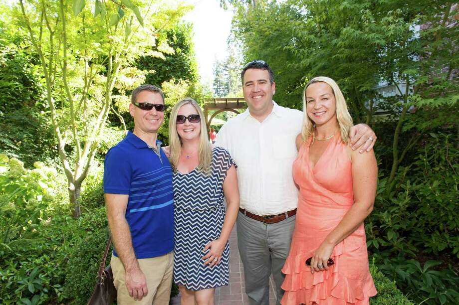 Colin Crawford, Nicole Crawford, Craig Crawford and Maggie Crawford at CASA of San Mateo County's Auxiliary Garden Party on August 24. 2014. Photo: Susana Bates For Drew Altizer, Drew Altizer Photography / DREW ALTIZER PHOTOGRAPHY