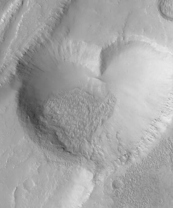 Scientists discovered a valentine from Mars when a camera on the Mars Global Surveyor shot a heart-shaped pit, formed when a straight-walled trough collapsed. The pit is about 1.4 miles (2.3 kilometers) at its widest. The photo was taken by the Mars Orbiter Camera on the Mars Global Surveyor. Photo: NASA, Getty Images / Getty Images North America