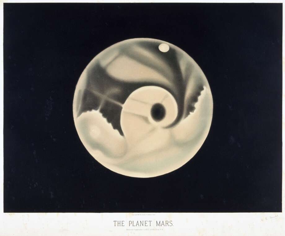 Colour print by Etienne Leopold Trouvelot (1827-1895), one of a set of 15, made by him whilst in the United States between 1872 and 1881. The lithographs are based on the French artist's observations from various American observatories. Titled 'The Planet Mars', the print shows the appearance of the Red Planet on 3 September 1877. During that year, Mars was well paced for observation as it came especially close to the Earth, appearing as a bright red star in the night sky. This pastel drawing shows the prominent feature 'Solis Lacus' also known as the 'Eye of Mars'. Today, this dark area is known to be a plain and is named Solis Planum. Photo: Science & Society Picture Librar, SSPL Via Getty Images