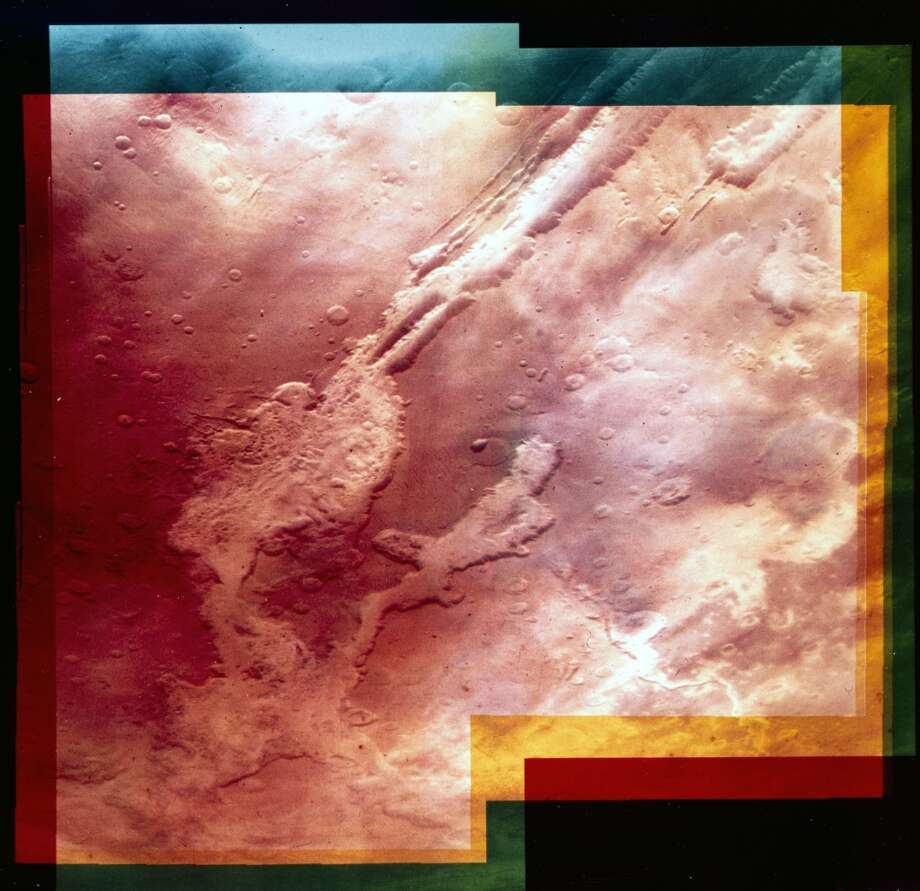 This view was taken by the Viking Orbiter 1 spacecraft. These canyons are some 4000 kilometres long and are over 6 kilometres deep in places. They are thought to have been formed by the Martian crust being stretched apart by the formation of another large landform, the Tharsis Bulge, rather than by erosion by water in the past. Two Viking spacecraft were launched towards Mars by NASA in 1975, each carrying a lander spacecraft and an orbiter. Both successfully landed their probes on Mars to study the Martian environment, soil constituents and to search for simple life forms. No evidence of life was found, but more recent studies of the Martian landscape suggest that in the past surface water may have been present, which could have enabled life to exist. Photo: Science & Society Picture Librar, SSPL Via Getty Images