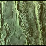 Huge Martian canyon, Valles Marineris, as recorded by Viking I spacecraft during mission to study Mars from orbit.