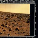 The image shows a red rock-strewn terrain. Two Viking spacecraft were launched towards Mars in 1975, each carrying a lander spacecraft and an orbiter. Both successfully landed their probes on Mars to study the Martian environment, soil constituents and to search for simple life forms - none were found. Viking 2 was launched on 9th September 1975 and landed in the Utopia Planitia region of Mars on 3rd September 1976.