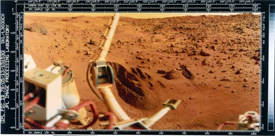 The image shows a red rock-strewn terrain and part of the lander itself. The trench dug by the soil retrieval scoop can be seen in the centre of the picture. Two Viking spacecraft were launched towards Mars in 1975, each carrying a lander spacecraft and an orbiter. Both successfully landed their probes on Mars to study the Martian environment, soil constituents and to search for simple life forms - none were found. Viking 2 was launched on 9th September 1975 and landed in the Utopia Planitia region of Mars on 3rd September 1976. Photo: Science & Society Picture Librar, SSPL Via Getty Images