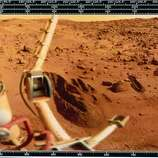 The image shows a red rock-strewn terrain and part of the lander itself. The trench dug by the soil retrieval scoop can be seen in the centre of the picture. Two Viking spacecraft were launched towards Mars in 1975, each carrying a lander spacecraft and an orbiter. Both successfully landed their probes on Mars to study the Martian environment, soil constituents and to search for simple life forms - none were found. Viking 2 was launched on 9th September 1975 and landed in the Utopia Planitia region of Mars on 3rd September 1976.