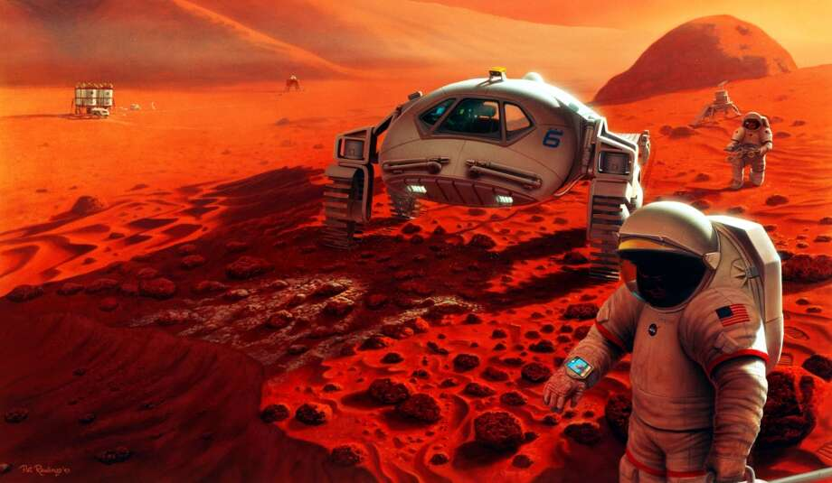 After driving a short distance from their landing site, two explorers stop to inspect a robotic lander and its small rover in this artist's concept of a future Mars mission. This stop also allows the crew to check the life support systems of their rover and space suits within walking distance of the base. Photo: Science & Society Picture Librar, SSPL Via Getty Images