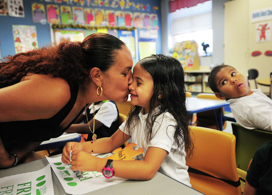 Jessenia Pagan, of Bridgeport, gives a kiss goodbye to her daughter, Ana'Gee Gonzalez, 5, on her first day of kindergarten at Luis Munoz Marin School in Bridgeport, Conn. on Thursday, August 28, 2014. Photo: Brian A. Pounds / Connecticut Post