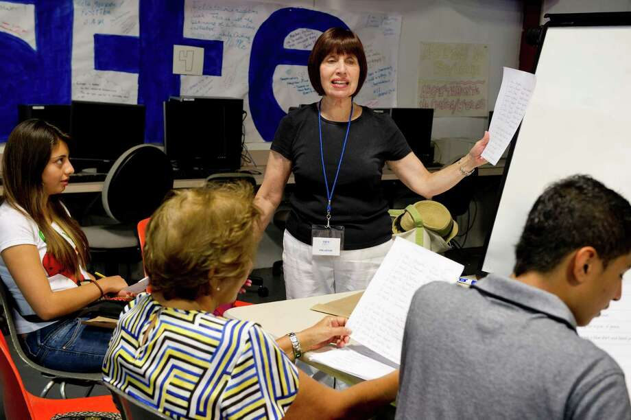 Barri Kaye, ESL volunteer, teaches English at Neighbor's Link in Stamford, Conn., on Thursday, August 28, 2014. Photo: Lindsay Perry / Stamford Advocate