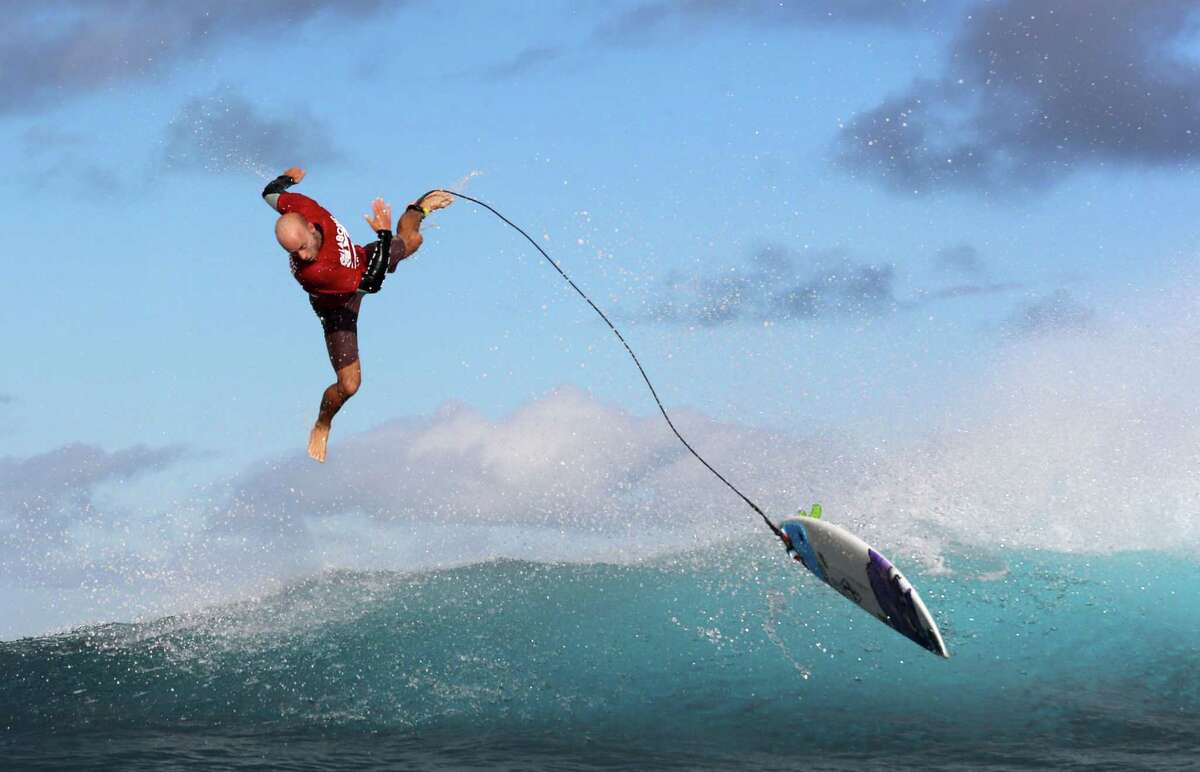 Australian surfer Nathan Hedge competes on August 9, 2014 during trials for the 2014 Billabong Pro Tahiti surf competition, in the Hava'e pass, off Teahupo'o in the southern Pacific ocean island of Tahiti, French Polynesia. The Billabong surf competition started on August 15, 2014.