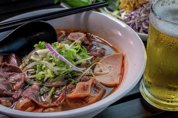 O'Mai Cafe, far left, serves up   bun bo hue, a beefy, seafood-y noodle soup, above, from Vietnam that balances sweet, salty, sour and spicy. The Inner Richmond restaurant also features beef carpaccio, left, that's more like a red-meat ceviche covered in shallots and basil.