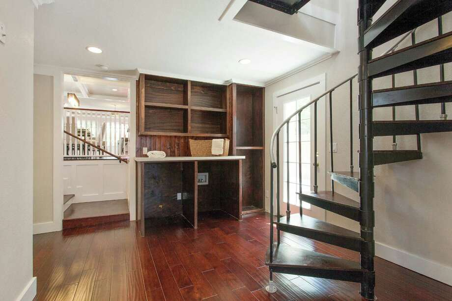 The office sits by a spiral staircase in a secluded portion of the home. Photo: OpenHomesPhotography.com / ONLINE_CHECK