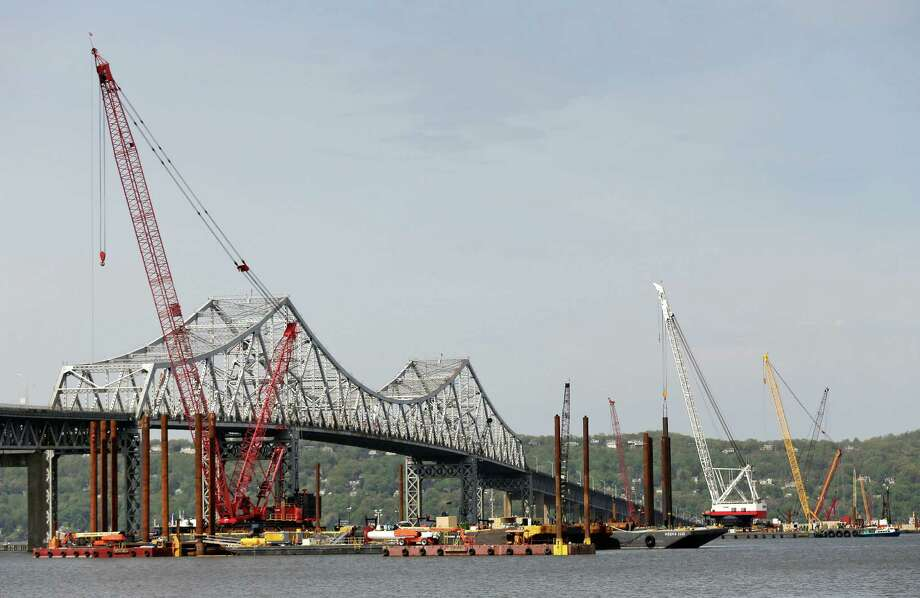 FILE--In this May 13, 2014 file photo, construction crews use barges and cranes as work continues on a replacement for the 58-year-old Tappan Zee Bridge spanning the Hudson River near Tarrytown, N.Y. (AP Photo/Julie Jacobson, File) Photo: Contributed Photo, Associated Press / Stamford Advocate Contributed