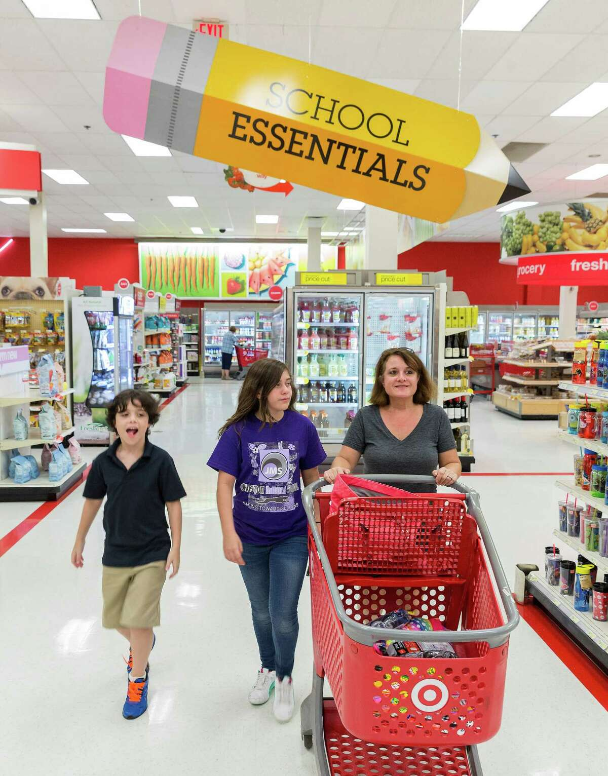 Carrie Consolvo shops with her children Wesly and Ellie at the Target store at 4323 San Felipe. Labor Day Weekend. Mom Carrie Consolvo shops for school supplies with 11-year-old Ellie Consolvo and 10-year-old Wesly Consolvo. Wednesday August 27, 2014 (Craig H. Hartley/For the Chronicle)