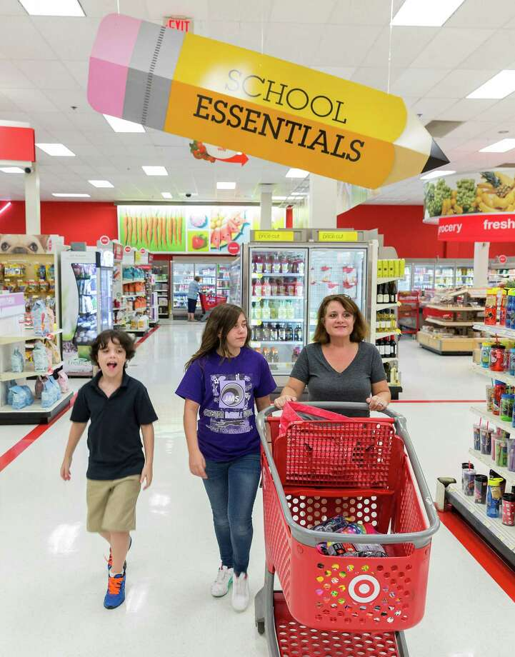Carrie Consolvo shops with her children Wesly and Ellie at the Target store at 4323 San Felipe. Labor Day Weekend. Mom Carrie Consolvo shops for school supplies with 11-year-old Ellie Consolvo and 10-year-old Wesly Consolvo. Wednesday  August 27, 2014 (Craig H. Hartley/For the Chronicle) Photo: Craig Hartley, Freelance / Copyright: Craig H. Hartley