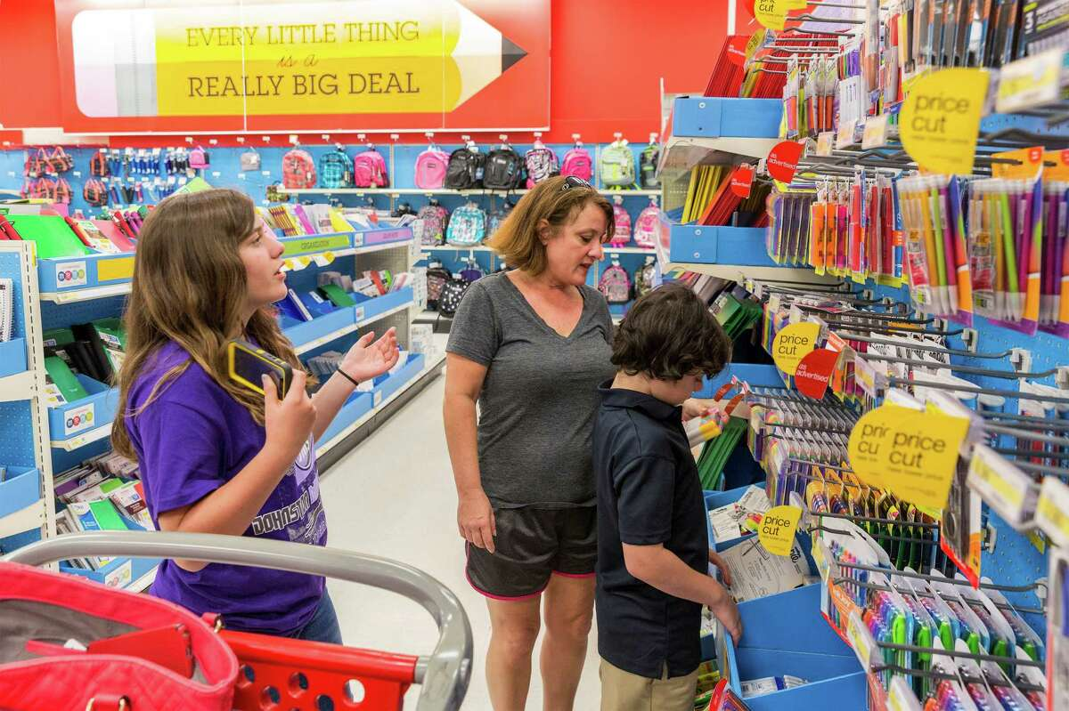 Target store, 4323 San Felipe. Retailers are expecting lots of back-to-school shopping over Labor Day Weekend. Mom Carrie Consolvo shops for school supplies with 11-year-old Ellie Consolvo and 10-year-old Wesly Consolvo. Wednesday August 27, 2014 (Craig H. Hartley/For the Chronicle)