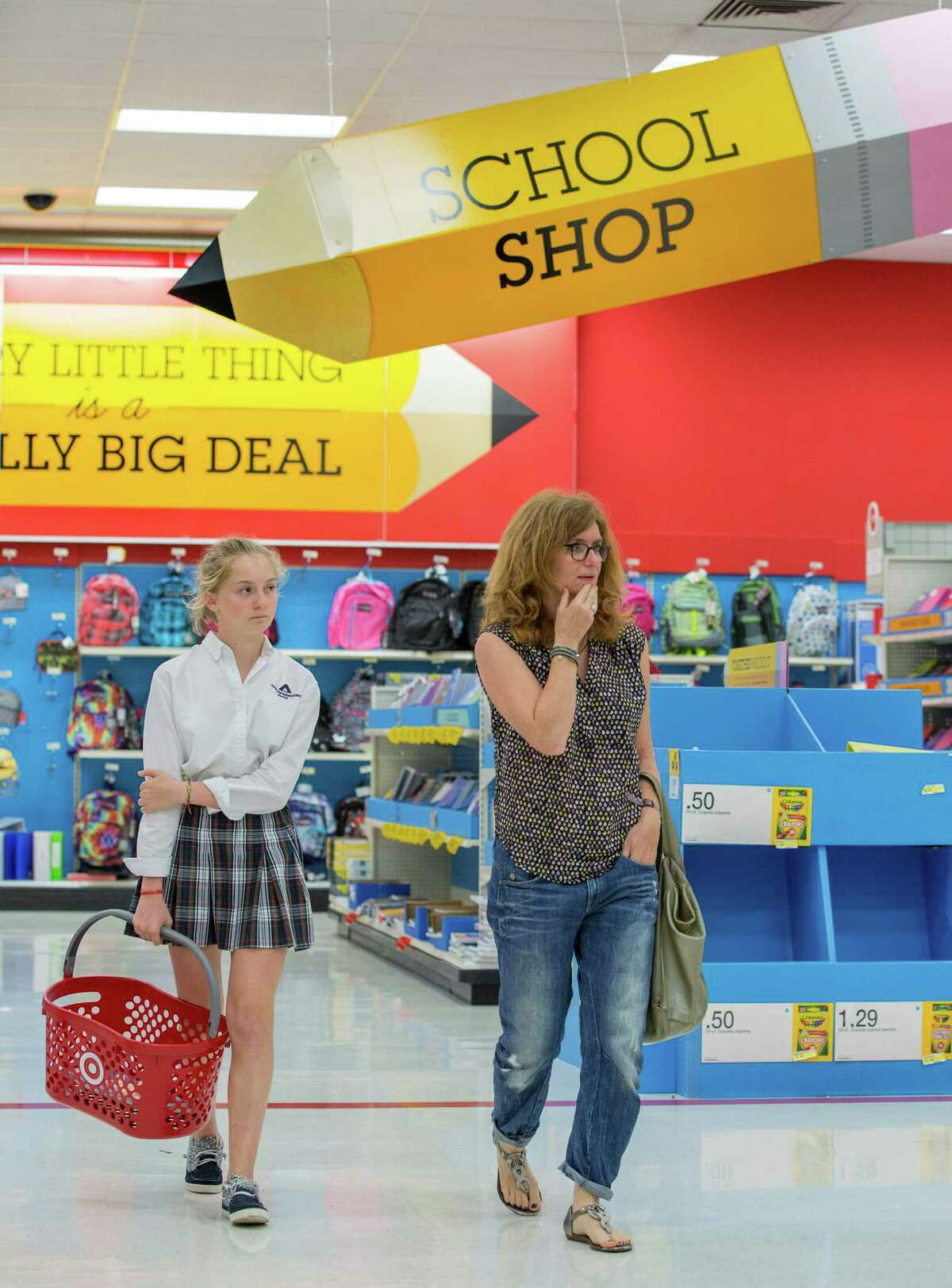 Target store, 4323 San Felipe. Retailers are expecting lots of back-to-school shopping over Labor Day Weekend. Mom Gino Coulom and 13-year-old Stella Coulom finish up their shopping for school supplies. Wednesday August 27, 2014 (Craig H. Hartley/For the Chronicle)