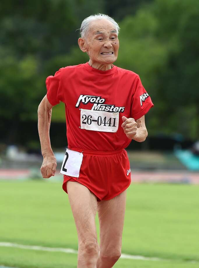 """While we were helping ourselves to more fries,103-year-old Japanese sprinter Hidekichi Miyazaki   was running the men's 100-meter dash at a Japan Masters Athletics competition in Kyoto.    Miyazaki, nicknamed the """"Golden Bolt,"""" holds the 100m record for centenarians and plans to race   for at least another five years. He says his secret weapon is his daughter's tangerine jam. Photo: Toru Yamanaka, AFP/Getty Images"""