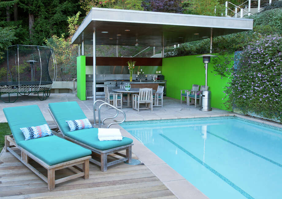 The three-lane swimming pool sits beside a covered outdoor kitchen at 27 Red Rock Way in San Rafael. Photo: Patrick Carney/CarneyPhoto.com / Patrick Carney/CarneyPhoto.com / ONLINE_CHECK