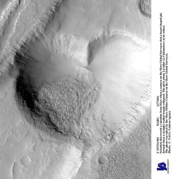 Scientists discovered a valentine from Mars when a camera on the Mars Global Surveyor shot a heart-shaped pit, formed when a straight-walled trough collapsed. The pit is about 1.4 miles (2.3 kilometers) at its widest. The photo was taken by the Mars Orbiter Camera on the Mars Global Surveyor. Photo: NASA, Getty Images