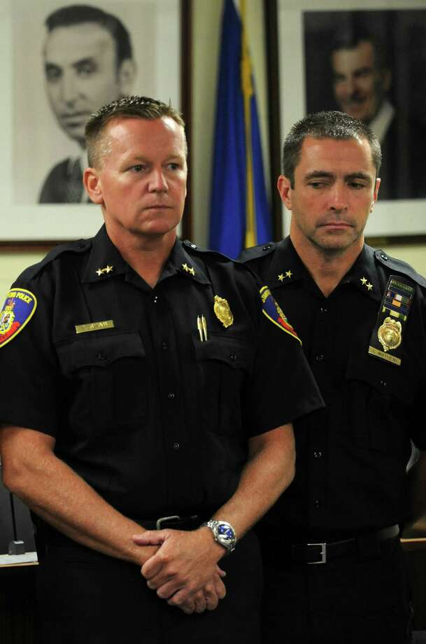 Assistant chiefs of police Timothy Shaw and James Matheny attend a press conference at the Stamford Police Department in Stamford, Conn. on Thursday, Aug. 28, 2014. The suspect in the stabbing death of Mahomed Kamal has been identified by police as Shota Mekoshvili. Kamal, a Stamford taxi driver was killed on Doolittle Road in Stamford, Conn., on Wednesday, August 27, 2014. Photo: Cathy Zuraw / Stamford Advocate