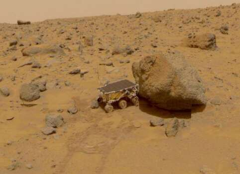 View of the NASA Pathfinder Sojourner Rover robotic data gathering vehicle exploring the surface terrain of the planet Mars, 1997. Photo: NASA, Getty Images