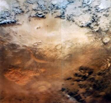 Dust storms such as this are common on Mars, sometimes covering up to half the planet?s surface. Two Viking spacecraft were launched towards Mars by NASA in 1975, each carrying a lander spacecraft and an orbiter. Both successfully landed their probes on Mars to study the Martian environment, soil constituents and to search for simple life forms. No evidence of life was found, but more recent studies of the Martian landscape suggest that in the past abundant surface water may have been present, which could have enabled life to exist. Today Mars has a very thin atmosphere, mainly of carbon dioxide. No liquid surface water appears to exist, but there are permanent polar ice caps, made up of frozen water and carbon dioxide (dry ice). Photo: Science & Society Picture Librar, SSPL Via Getty Images