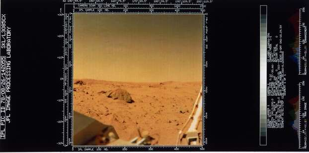 This view of the red surface of Mars also shows part of the spacecraft itself. Two Viking spacecraft were launched towards Mars in 1975, each carrying a lander spacecraft and an orbiter. Both successfully landed their probes on Mars to study the Martian environment, soil constituents and to search for simple life forms - none were found. Photo: Science & Society Picture Librar, SSPL Via Getty Images
