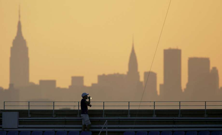 A New York moment: A spectator takes in the view from the top of Arthur Ashe Stadium during the second round of the 