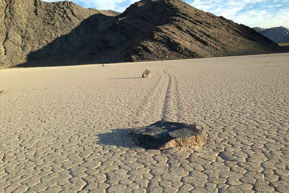 One of several hundred rocks that have left trails as they moved across the surface of Racetrack Playa in California's Death Valley National Park on August 18, 2014. There were several theories for the strange activity, but Richard Norris, a paleobiologist at Scripps Institution of Oceanography, and his cousin James Norris, a research engineer, were the first to photograph rocks in motion. (Louis Sahagun/Los Angeles Times/MCT)