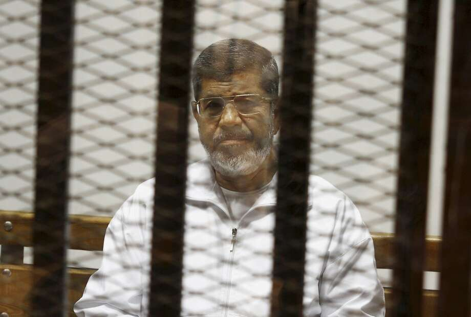Egypt's ousted Islamist President Mohammed Morsi sits in a defendant cage in a Cairo courthouse in May. Photo: Tarek El-Gabbas, Associated Press