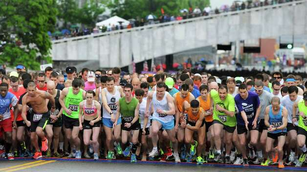 Runners start the 35th running of the CDPHP Workforce Team Challenge on Thursday, May 15, 2014, in Albany, N.Y. (Cindy Schultz / Times Union) Photo: Cindy Schultz / 00026907A
