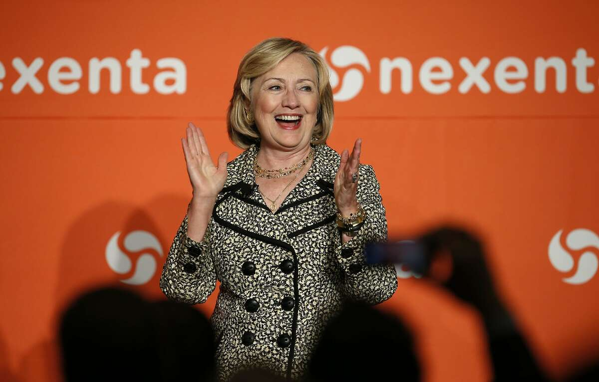 Former Secretary of State Hillary Rodham Clinton applauds the crowd following a fireside chat during the Nexenta OpenSDx Summit at the St. Regis Hotel in San Francisco, Calif., on Thursday Aug. 28, 2014.