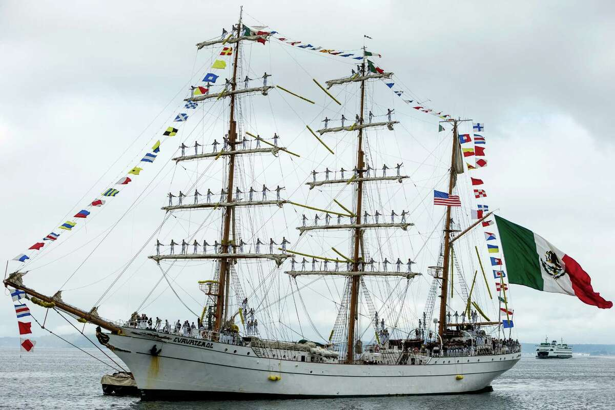 With dozens of sailors clinging to the masts, the Mexican navy tall ship Cuauhtémoc pulls into Seattle as part of its