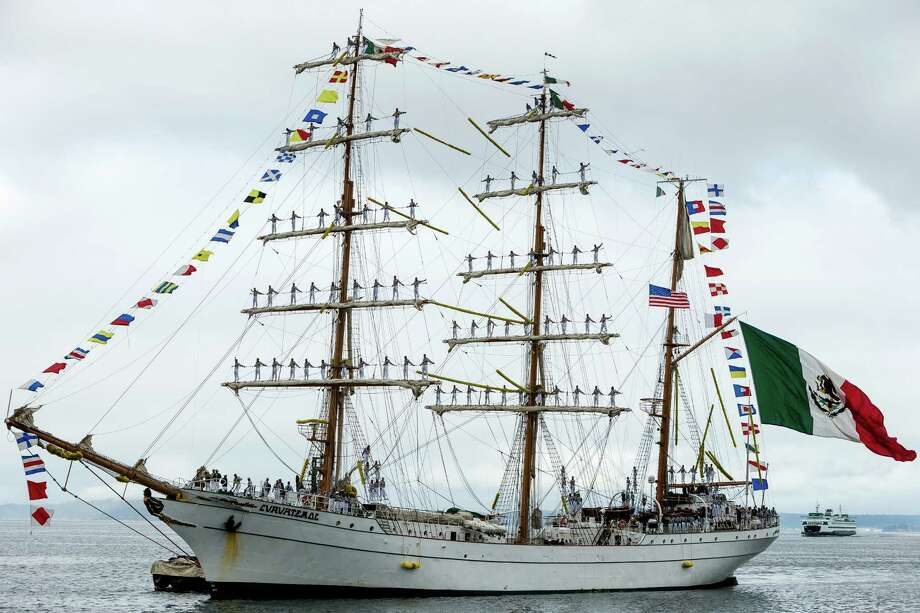 "With dozens of sailors clinging to the masts, the Mexican navy tall ship Cuauhtémoc pulls into Seattle as part of its ""America 2014"" instruction tour Thursday, Aug. 28, 2014, at Pier 66 in Seattle. Cuauhtémoc is a teaching vessel where cadets are trained in international waters before graduating as officials. It was built in Spain in 1982 and has since sailed around the world for more than  30 years, bearing a message of peace and friendship at each port in which the boat docks. Photo: JORDAN STEAD, SEATTLEPI.COM / SEATTLEPI.COM"